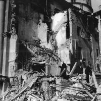 Don Igino Guardiani tra le macerie della canonica di San Pietro bombardata dagli alleati