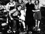 """Luisa Calzetta, la """"Tigrona"""", militante in diverse formazioni del piacentino. Nata a New York nel 1919, maestra. Le venne conferita la medaglia d'argento al valor militare alla memoria, con la seguente motivazione: """"Indomita partigiana, nel nobile tentativo di portare al sicuro un componente della propria formazione che era rimasto ferito in combattimento, veniva circondata da un folto numero di nemici. Impugnata la pistola, si difendeva con eroica fermezza fin tanto che, sopraffatta, veniva trucidata. Fulgido esempio di abnegazione e di attaccamento alla Causa""""."""